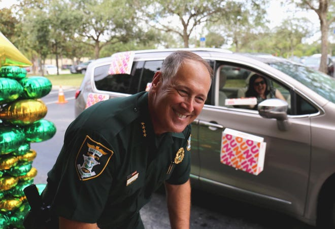 "Community members, law enforcement officer and family honored Sarasota County Sheriff Tom Knight Tuesday, Oct. 20, 2020 with a parade of gratitude at sheriff's headquarters. The Board of Sarasota County Commissioner's proclaimed Tuesday, ""Sheriff Thomas M. Knight Day."""