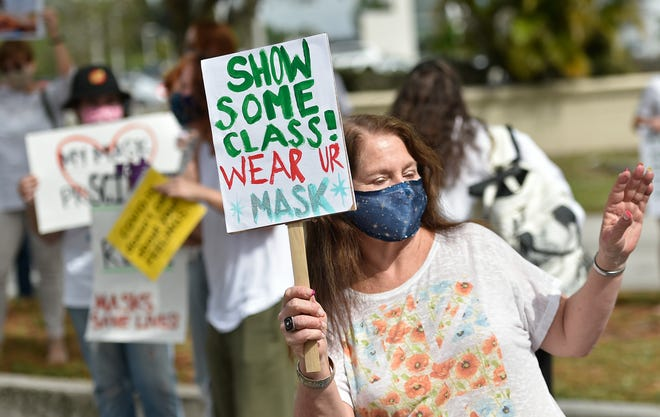 Oak Park teacher Mary Holmes takes part in a pro-mask demonstration outside the Sarasota County School Board building, in Sarasota.