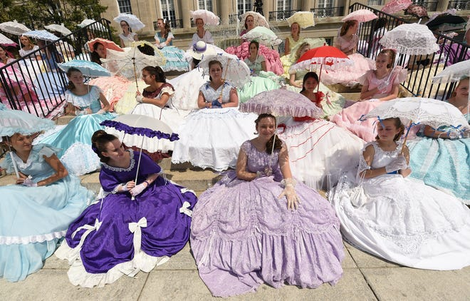 Azalea Belles sit on the front steps of the Alton Lennon Federal Building on Wednesday, April 11, 2018 during the N.C. Azalea Festival Queen's Coronation in Wilmington, N.C.