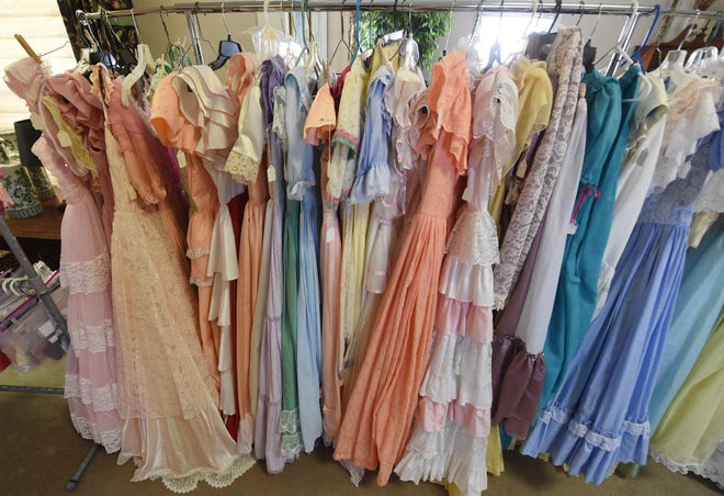 Rows of dresses are lined up for the Cape Fear Garden Club Azalea Belles during a dress fitting at Drapery World in Wilmington, N.C.,  January 25, 2020. Alma