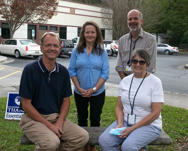 Hospice team members: front, left to right: Clayton Gaskins, director, and Dianne Brideson, clinical supervisor; second row: Tammy Petteway, office manager, and Dr. Bob Fisher, medical director. [Bill Hand / Sun Journal Staff]