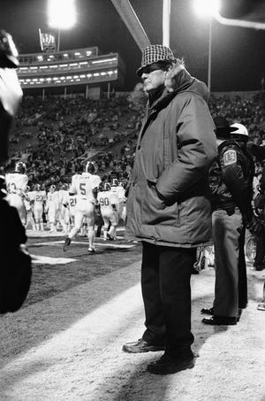 Alabama coach Paul Bear Bryant watches his team warm up prior to Liberty Bowl, Wednesday, Dec. 29, 1982, in Memphis, Tenn. The game against Illinois was Bryant's last as head coach of the Crimson Tide.