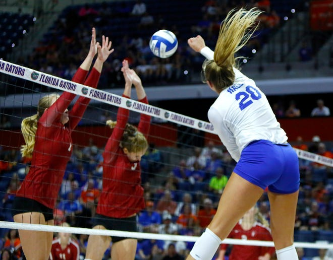 Thayer Hall (20) is back to lead the Florida Gators volleyball team this season.