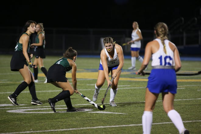 Olentangy's Dani Beidelman (facing) defends against Dublin Coffman's Reese Mclntyre on Sept. 9. The Braves defeated Liberty 3-1 to open the district tournament Oct. 20.