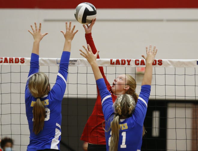 Thomas' Megan Peer spikes the ball against Olentangy's Sophia Weithman (left) and Trinity Swearengen earlier this season. The Cardinals' season ended Oct. 22 with a 25-18, 26-24, 25-18 loss at Pickerington Central in the second round of the Division I district tournament.