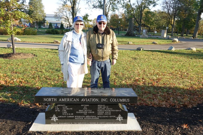 Billie McComas-Bower (left) and Nolan Leatherman, who both worked for North American Aviation near Whitehall, collaborated on raising funds for and designing a memorial bench installed Oct. 16 at Whitehall Community Park, 402 N. Hamilton Road. The bench depicts aircraft built by North American Aviation, which later became Rockwell International. The Columbus plant closed in 1988.