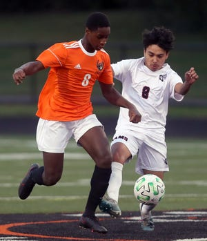 Whitehall's Jose Alverado (right) and Delaware's Abdul Kawa battle for possession Sept. 17. The Rams opened the Division I district tournament Oct. 24 against Westerville North after the game was pushed back two days because of a COVID-19 quarantine.