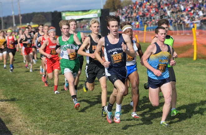 Grandview Heights' Derek Amicon competes in last year's Division III state cross country meet on the way to winning the championship. Amicon won his second consecutive MSL-Ohio title Oct. 17 at Buckeye Valley.