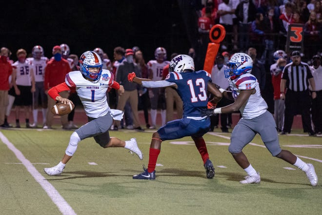 Midlothian Heritage quarterback Daelin Rader (1) avoids the rush from Life Waxahachie's Christopher Gillespie (13) during a District 5-4A (I) game at Mustang Stadium last season. The Jaguars will have to replace a large number of graduates, including Rader.