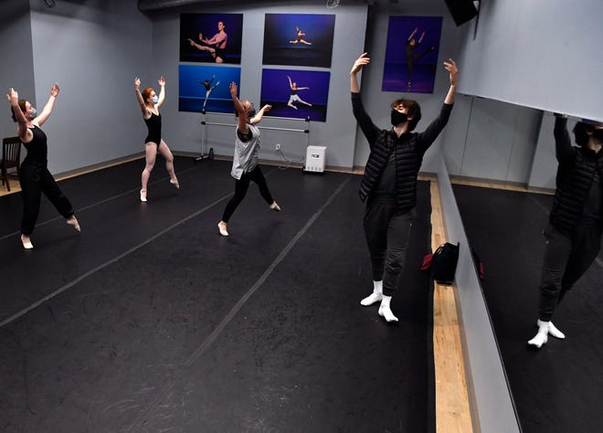 A trio of Abilene Christian University students follow along as Alex Maryianowski demonstrates a series of moves during the Advanced Ballet class at Williams Performing Arts Center's dance studio Tuesday.