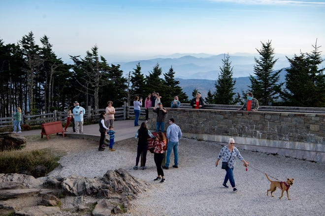 Visitors take in the view from the summit at Mount Mitchell State Park on Oct. 19, 2020.