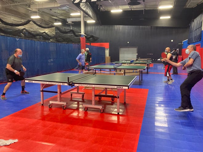 Members of the Battle Creek Table Tennis Club play at Full Blast Recreation Center on Monday, Oct. 19, 2020.