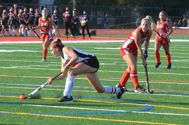 Kingsway junior captain Victoria Griffiths takes a shot on a penalty corner against Delsea.