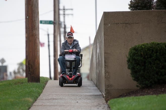 George Rooks' rides his scooter down West Plane Street in Bethel on Tuesday, Oct. 20, 2020.