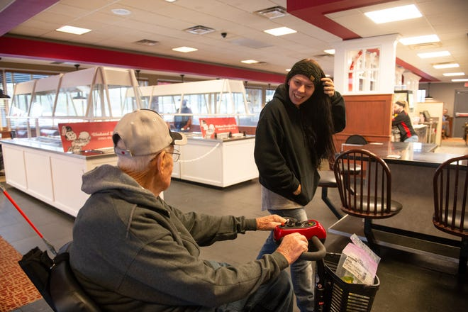 George Rooks' chats with his friend Alicia Corbett, of Oklahoma, at Frisch's Big Boy in Bethel on Tuesday, Oct. 20, 2020. Rooks regularly visits Frisch's for lunch and chats with the employees and the regulars.