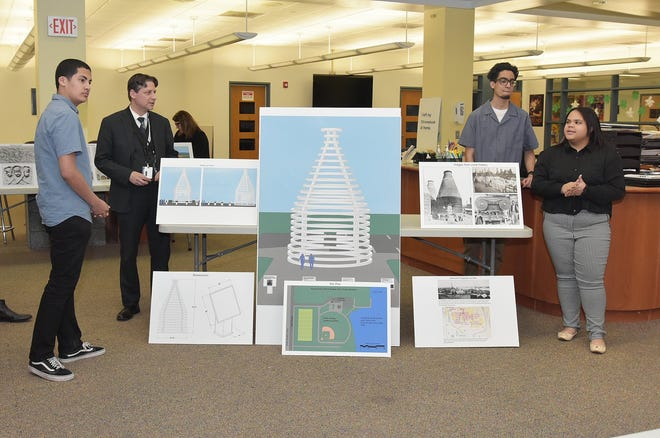 MCVTS Perth Amboy Campus students present their research on the city's terra cotta industry during the Tech Expo competition. From left are Willy Diez, Mark Nonestied of the Middlesex County Cultural and Heritage Commission, Jordie Inoa, and Vianny Luna. The final design of the historical marker that will be placed in the new waterfront park in Perth Amboy.
