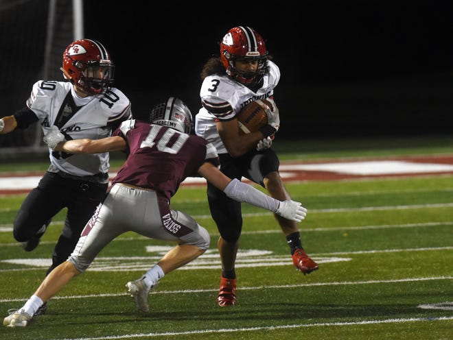 Braydon Johns runs with the ball for Coshocton in a loss to host Columbus Academy in the playoffs. Johns was tabbed All-MVL First Team and Small School Division running back of the year.
