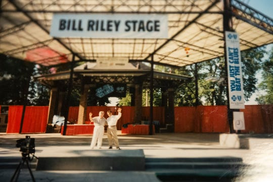 Bill Riley Sr. and Bill Riley Jr. stand together on the Bill Riley Stage at the Iowa State Fair.