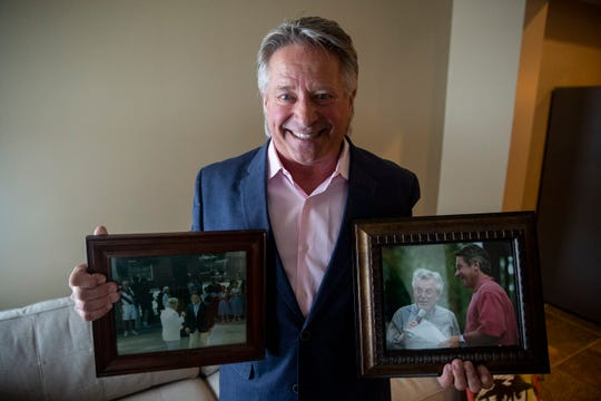 Bill Riley Jr. holds two photos of himself with his father, Bill Riley Sr. who created the Bill Riley Talent Search, on Monday, Oct. 19, 2020, at his home in Clive. After 25 years as the host of the Iowa State Fair staple, Riley plans to retire.
