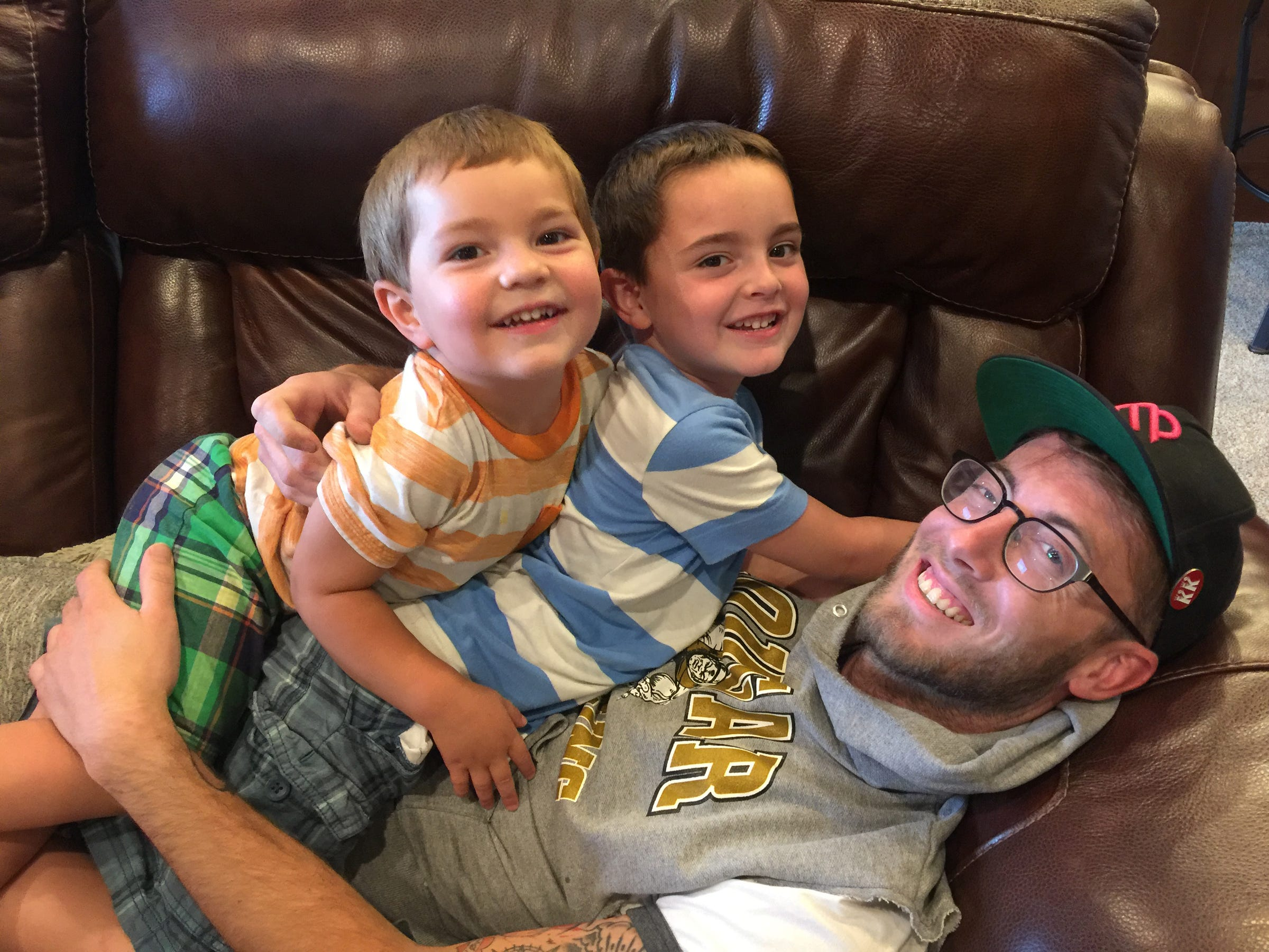 A family photo shows Austin Burnett with his nephews  Jensen, 3, left, and Jackson Rose, 5, in Albuquerque, New Mexico in July, 2018. Burnett, who prided himself as their uncle, died in his Wyandotte apartment on April 28, 2020 of an overdose.