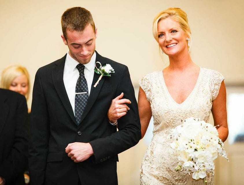 Austin Burnett was 19 in this photo as he walked his mother Kelly Opp down the aisle to Opp's father who gave her away at her wedding in Garden Grove, Calif. in February of 2013. Burnett died in his Wyandotte apartment on April 28, 2020 of an overdose.