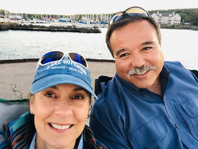 Lynn and Mike BeBeau, who found a little wooden boat on the shores of Lake Superior, 27 years after it was launched by teachers in Minnesota.