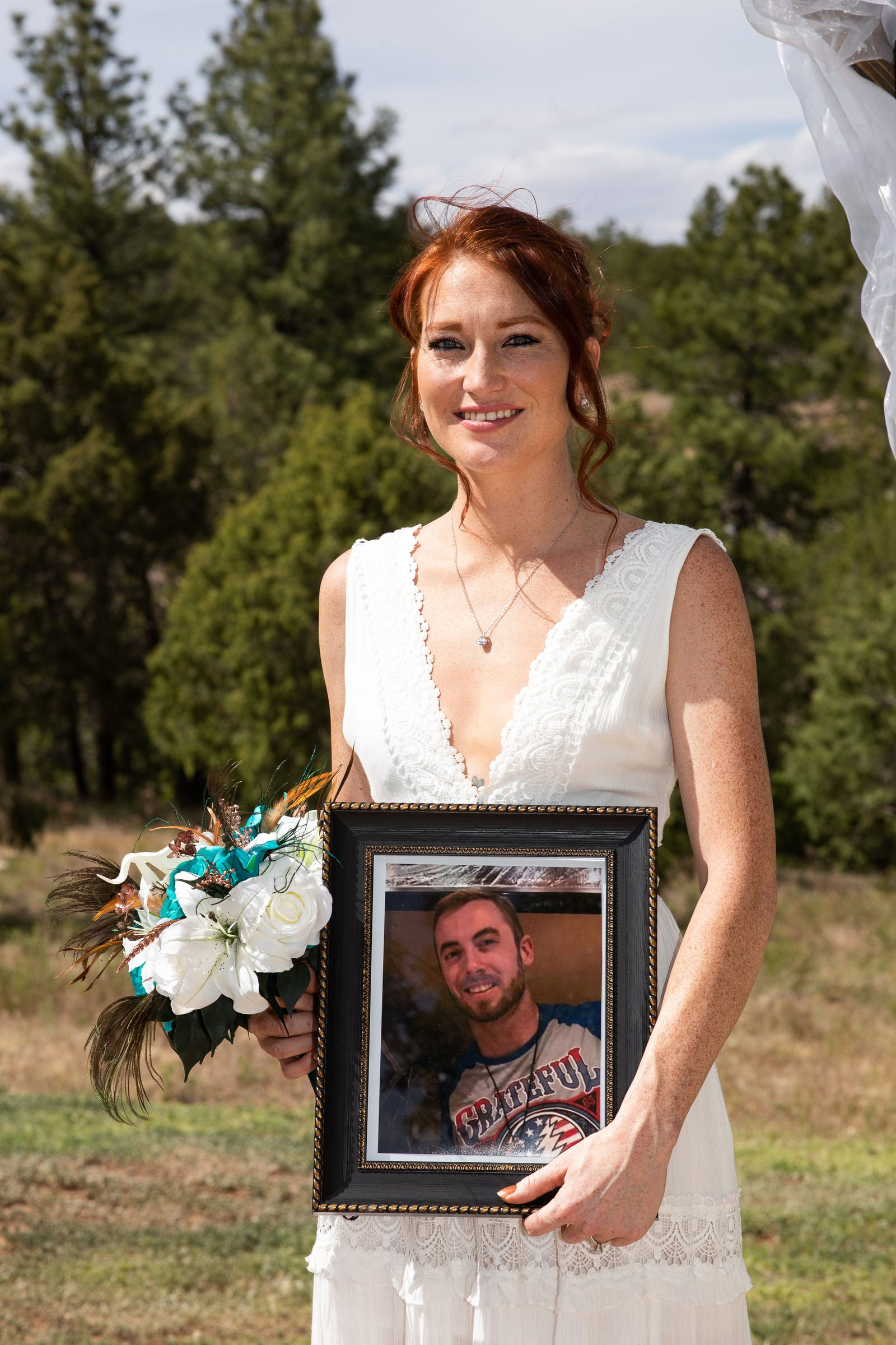Austin Burnett's sister Meagan Angelino holds a photo of him on her wedding day May 24, 2020 in Tijeras, New Mexico. Burnett died a month before her wedding in his Wyandotte apartment on April 28, 2020 of an overdose.