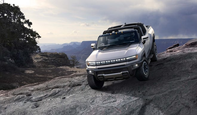 The $112,595, 2022 GMC Hummer EV will debut as a special launch edition in late 2021. The top-trim pickup truck will feature removable roof panels, 350-plus miles of range, and an automatic rear tonneau cover.