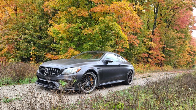 The 2020 Mercedes-AMG C63 S Coupe comes with Designo Graphite Grey Magno paint - aka, matte black-  that makes a striking contrast to Michigan's fall October colors.