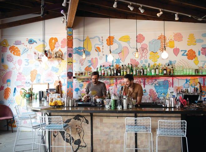 Bar tenders at Bar Margaret in the West Village prepare drinks.