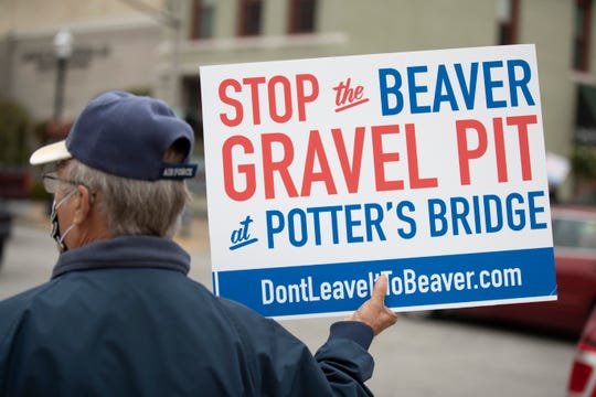 Outside of city hall, residents protest the plans to build a gravel pit next to Potter's Bridge Park in Noblesville, Ind. on Monday, October 19, 2020.