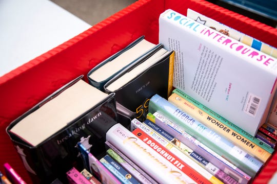 A bin of books is seen during an Iowa City Public Library Bookmobile stop, Tuesday, Oct. 20, 2020, at the Waterfront Hy-Vee parking lot in Iowa City, Iowa.
