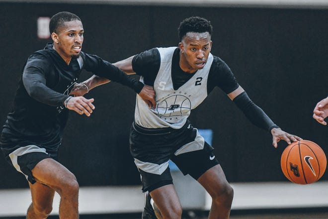 Purdue guard Eric Hunter Jr. (2) dribbles against Purdue guard Isaiah Thompson (11) during a men's basketball practice, Tuesday, Sept. 22, 2020 in West Lafayette.