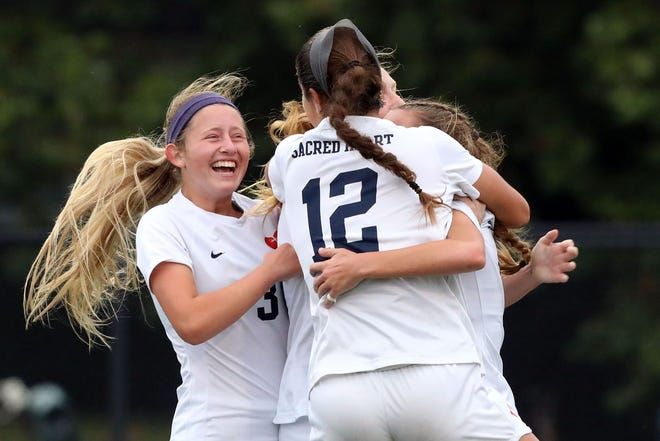 Sacred Heart celebrates after Mallory Glass scored a goal against Assumption during the the Seventh Region girls soccer semifinals at Assumption Green Champions Trace in Louisville, Kentucky.     October 19,  2020.