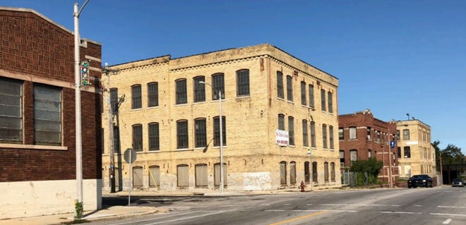 Community Within The Corridor will redevelop several historic former industrial buildings into apartments and other new uses.