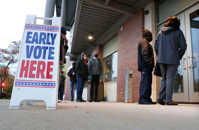 Milwaukee residents are lined up early outside the Washington Park Library to cast their ballots during early voting on Tuesday. Beginning Oct. 20, Wisconsin voters will have an 11-day window to vote early in their municipalities. Early voting is technically absentee voting and those ballots will be stored and opened on Election Day.