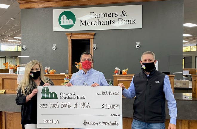 Farmers & Merchants Bank recently made a donation to the Food Bank of North Central Arkansas. Shown above are (from left) Amber Henry, Marketing and Community Relations Administrator for Farmers & Merchants Bank; Jeff Quick, CEO of the Food Bank; and Brandon Scallion, Market President for Farmers & Merchants Bank.