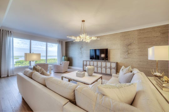 905 Great Room: The furnished move-in ready 905-residence at The Ronto Group's completed 27-floor, 120-unit Seaglass high-rise tower at Bonita Bay features furnishings selected by Robb & Stucky's Cynthia Bradford, Designer, ASID.  Priced at $1,845,000 with furnishings, the 905-floor plan offers a total of 3,353 square feet of living space with 2,889 square feet under air.