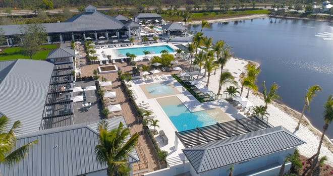 All three pools at The Club at Kalea Bay overlook the large lake at the high-rise community's entrance.