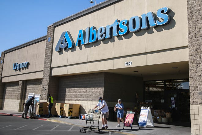Customers walk in and out of Albertsons, 2501 Main St., in Las Cruces. on Tuesday, Oct. 20, 2020. The New Mexico Environment Department published a rapid response COVID-19 watchlist on Tuesday and Albertsons on North Main is on it.