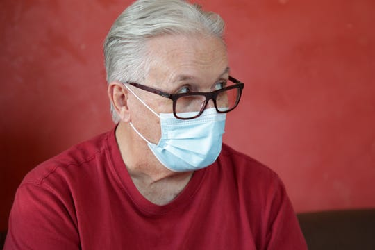 Lee Fournier sits in his hotel room provided by Project Roomkey on Sunday, October 11, 2020, at the Rodeway Inn & Suites in Indio, California.  Project Roomkey is a state effort to assist homeless people during the COVID-19 pandemic.
