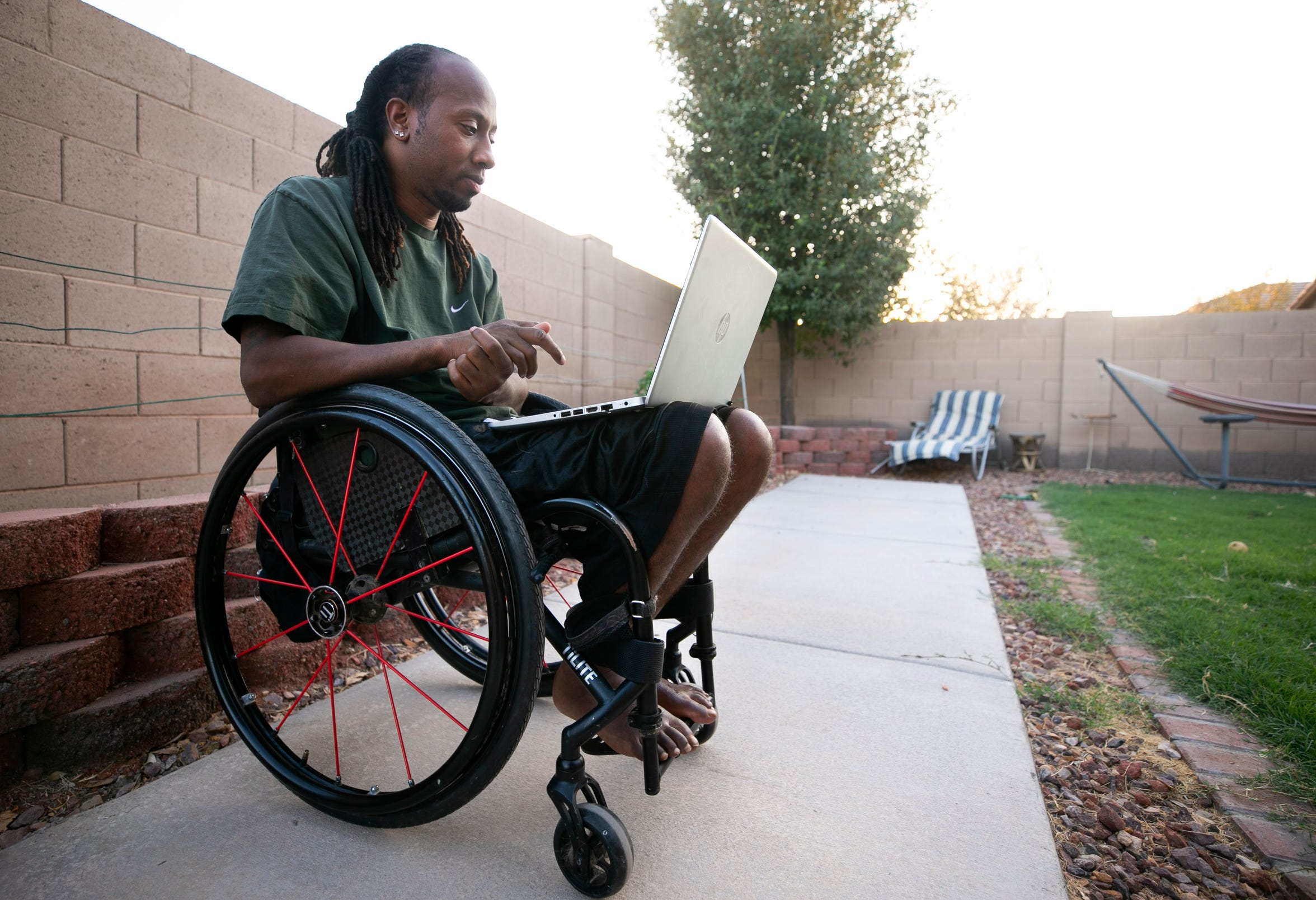 Joe Jackson, 30, who is paralyzed from the chest down, does a sports psychology Zoom meeting with his U.S. national wheelchair rugby teammates at his home in Maricopa on Sept. 24, 2020.