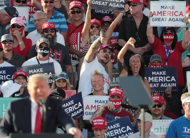Supporters react as then-President Donald Trump speaks during a 'Make America Great Again' rally in Tucson on Oct. 19, 2020.