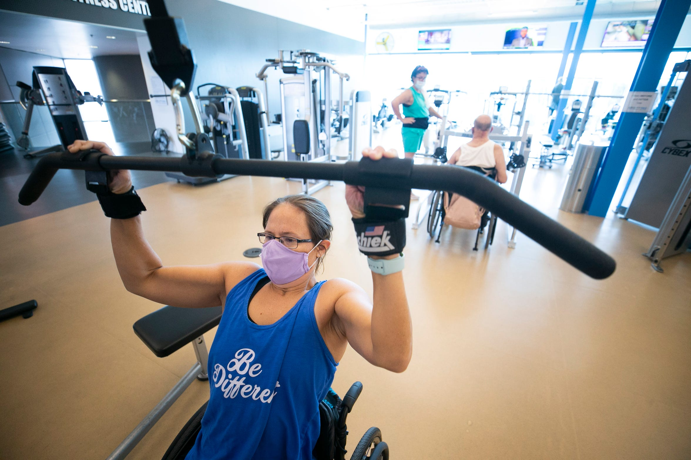 Jen Chaillie, 38, of Tempe, who is paralyzed from the chest down, lifts weights, at Ability360, a Phoenix fitness and community center for people with disabilities, on Sept. 22, 2020.