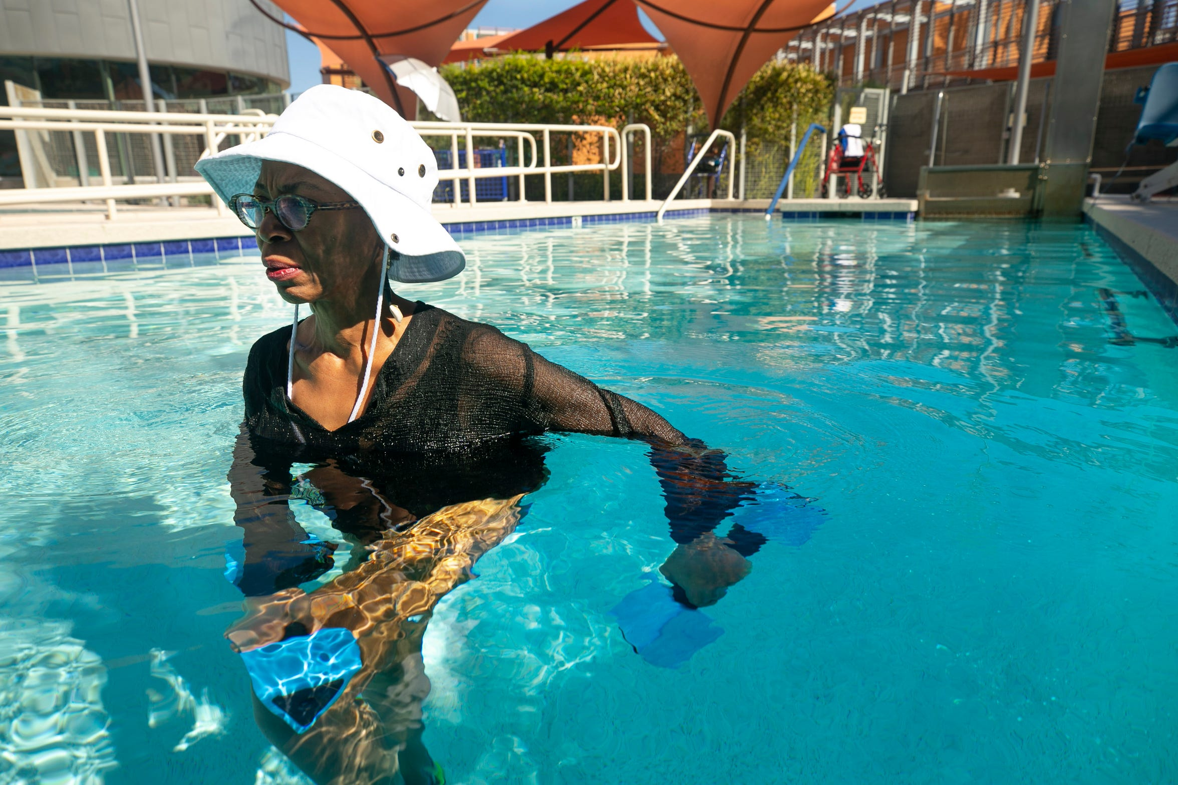 Oneka Temple, 50, of Laveen, does exercises therapy pool at Ability360, a Phoenix fitness and community center for people with disabilities, on Aug. 14, 2020.