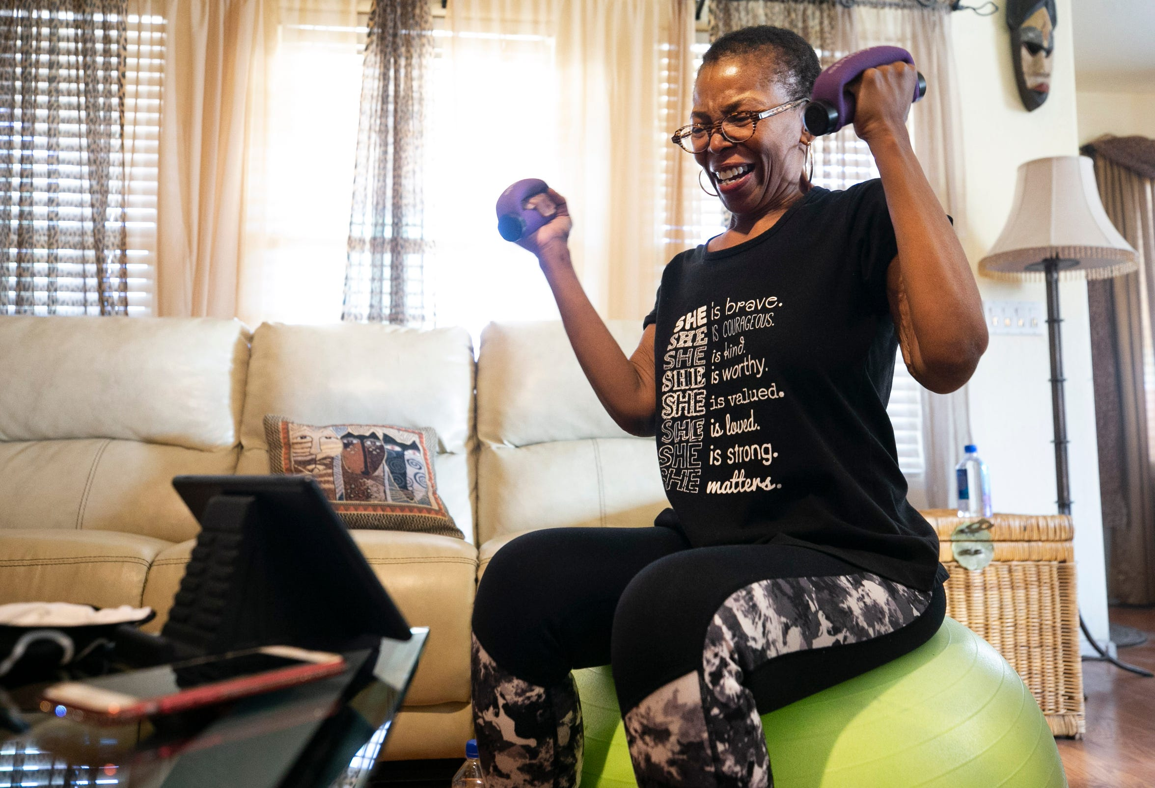 Oneka Temple, 50, of Laveen, does a personal training session through Zoom with Brielle Carter, program manager at Ability360, a Phoenix fitness and community center for people with disabilities, at her home in Laveen on Sept. 24, 2020.