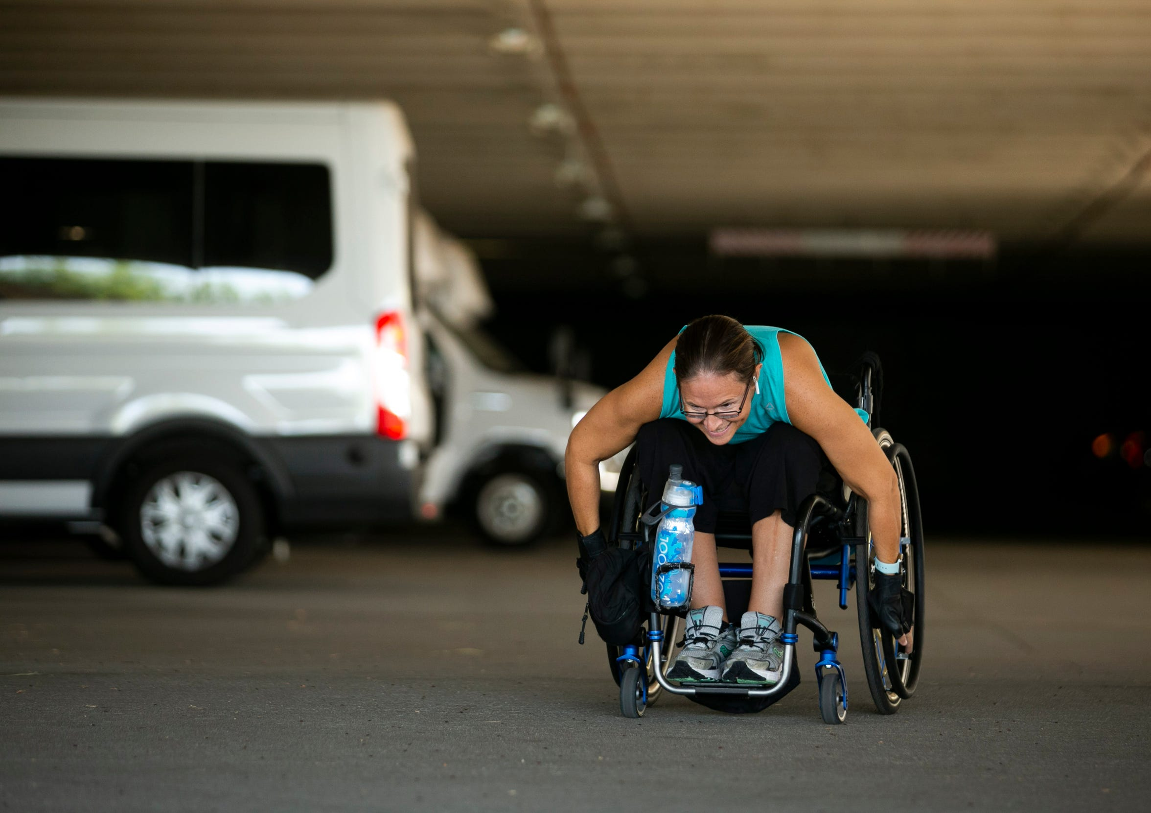 Jen Chaillie, 38, of Tempe, who is paralyzed from the chest down, pushes up the ramps in the parking garage at Ability360, a Phoenix fitness and community center for people with disabilities, on Sept. 2, 2020.