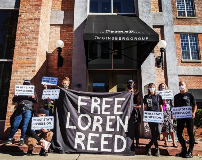 Protesters in support of Loren Reed stand outside the Flagstaff courthouse where Reed's detention hearing was held on Oct. 19, 2020.