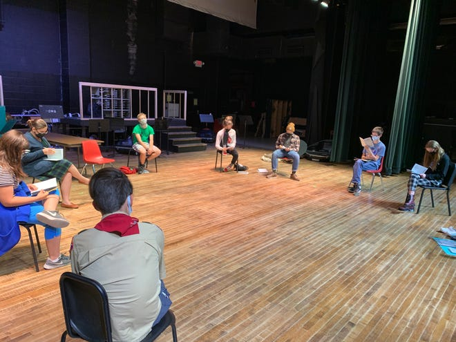 """Members of the Port Clinton Hight School Drama Club participate in their first read through for their upcoming """"Fall One Act Festival"""" while maintaining social distance at the PCHS Performing Arts Center."""