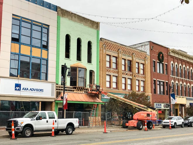 Construction workers work on developer Larry Jones Winkelman lofts project in downtown Port Huron on Oct. 19, 2020.